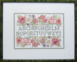 framed embroidery alphabetical book